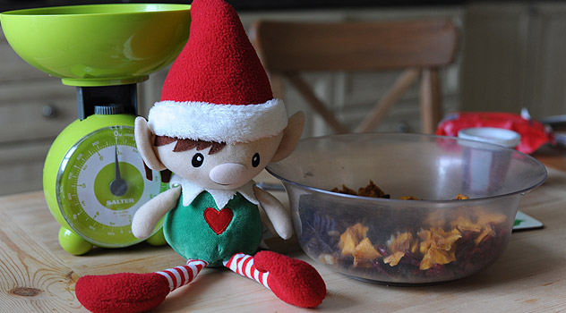 Elf With Ingredients for Christmas Cake Recipe