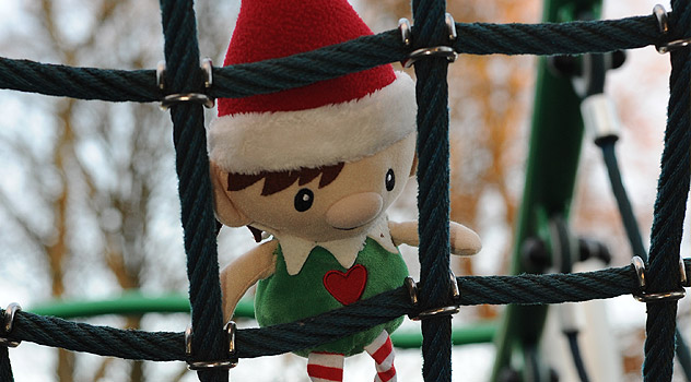 Elf on Climbing Frame in Park