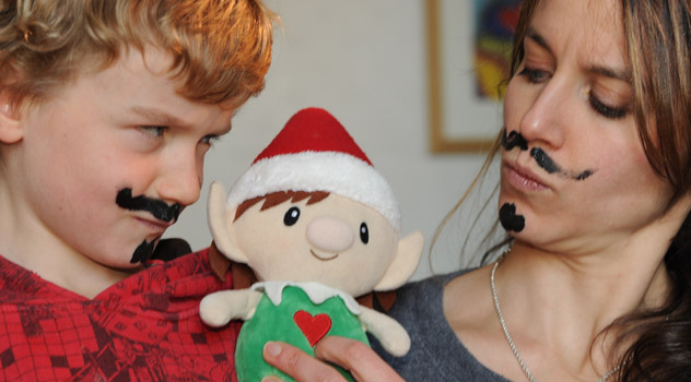 Christmas Elf Draws Moustache