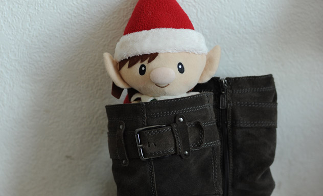 Magic Christmas Elf hiding in a pair of boots