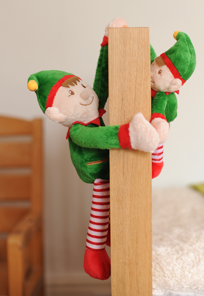 Christmas Elf hanging from bed