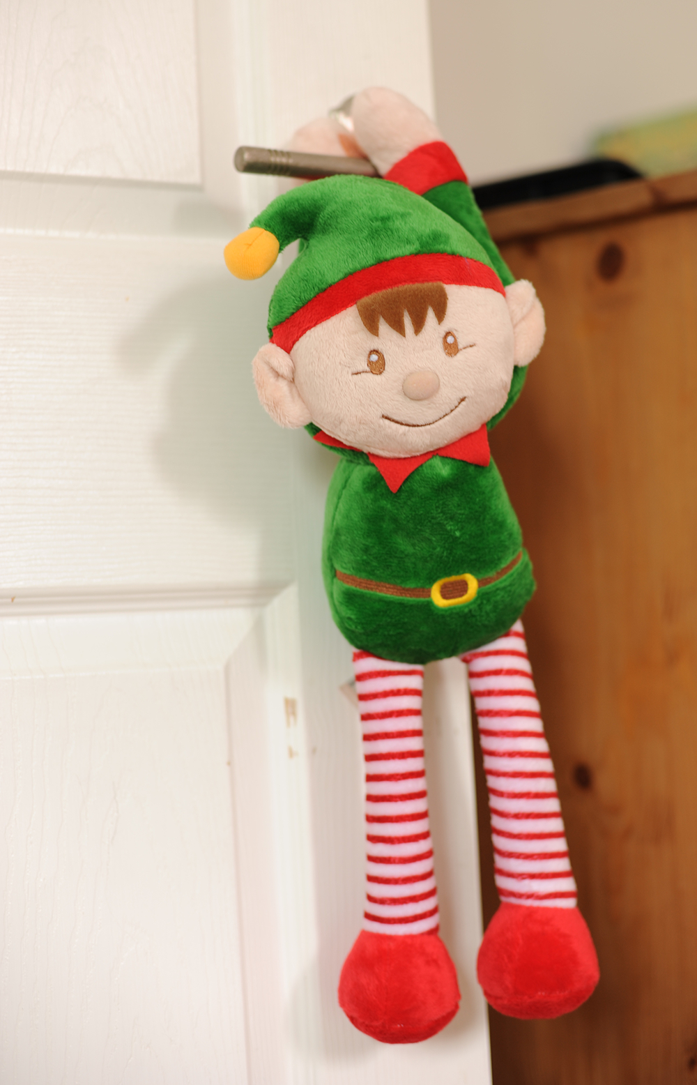 Christmas elf dangling from door handle